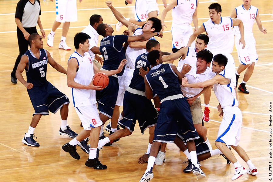 American Georgetown University men's basketball team and China's Bayi men's basketball team fight during a friendly game at Beijing Olympic Basketball Arena